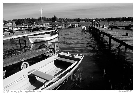 Boats and pier. Gotaland, Sweden (black and white)