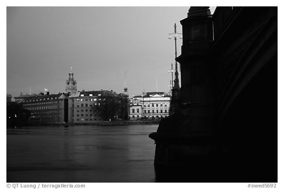 Bridge on Riddarfjarden and Gamla Stan, midnight twilight. Stockholm, Sweden (black and white)