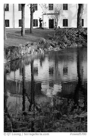 Building reflected in a lake, Skansen. Stockholm, Sweden (black and white)