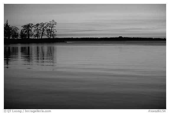Trees and sunset on Vattern Lake, Vadstena. Gotaland, Sweden (black and white)