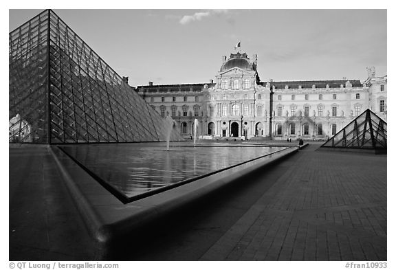 Pyramid, basins, and Sully Wing  in the Louvre, sunset. Paris, France (black and white)