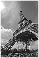 Eiffel tower and sun with crowds at base. Paris, France ( black and white)