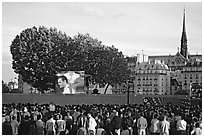 Crowds watch a broadcast of a soccer match near Hotel de Ville. Paris, France (black and white)
