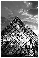 Louvre pyramid transparent at sunset. Paris, France (black and white)
