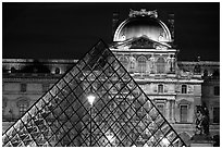 Pyramid and Louvre at night. Paris, France (black and white)