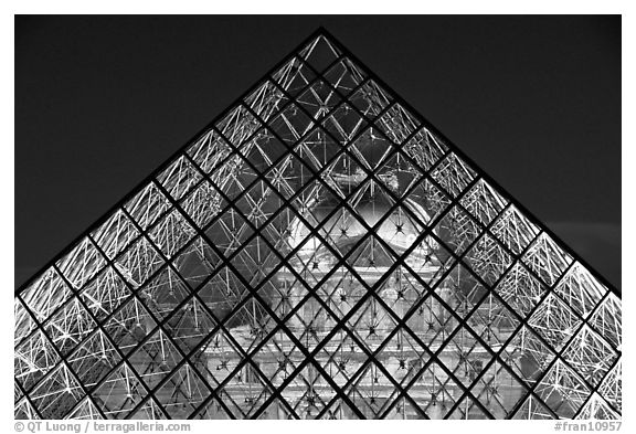 Louvre seen through pyramid at night. Paris, France (black and white)