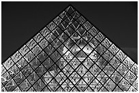 Louvre seen through pyramid at night. Paris, France ( black and white)
