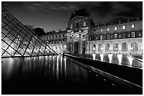 Basin, Pyramid, and Louvre at dusk. Paris, France ( black and white)