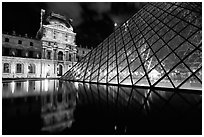 Louvre, Pei Pyramid and basin  at night. Paris, France ( black and white)