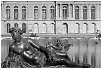 Statue, basin, and facade, afternoon, Palais de Versailles. France (black and white)