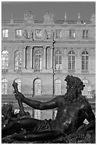 Statue, basin, and Versailles palace facade, late afternoon. France (black and white)