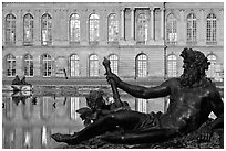 Statue, basin, and facade, late afternoon, Versailles Palace. France (black and white)