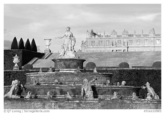 Fountain in the Versailles palace extensive gardens. France (black and white)