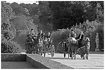 Horse carriages in the Versailles palace gardens. France (black and white)