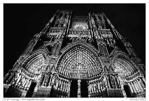 Looking up Notre Dame Cathedral laser-illuminated to recreate original colors, Amiens. France (black and white)