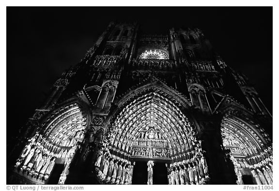 Looking up cathedral with doors laser-illuminated to recreate original colors, Amiens. France (black and white)