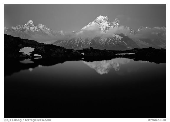 Aiguille Verte reflected in pond at dusk, Chamonix. France (black and white)