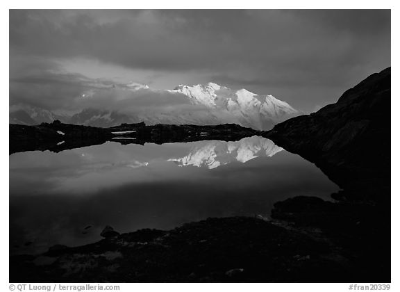 Mont Blanc range reflected in pond at sunset, Chamonix. France (black and white)