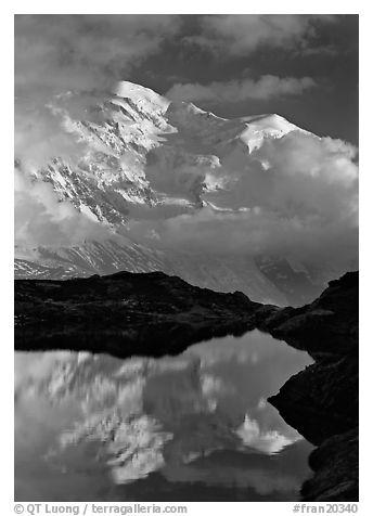 Mont Blanc and clouds reflected in pond, Chamonix. France (black and white)