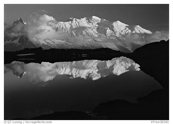 Mont Blanc reflected in pond at sunset, Chamonix. France (black and white)