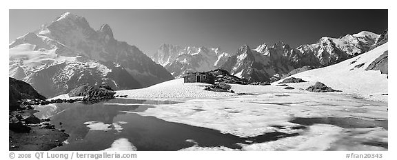 Partly Frozen Lac Blanc, Aiguille Verte, and Mont-Blanc range, Chamonix. France (black and white)