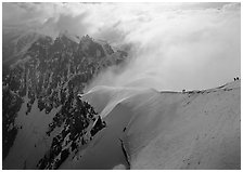 Alpinists on Aiguille du Midi ridge, Chamonix. France (black and white)