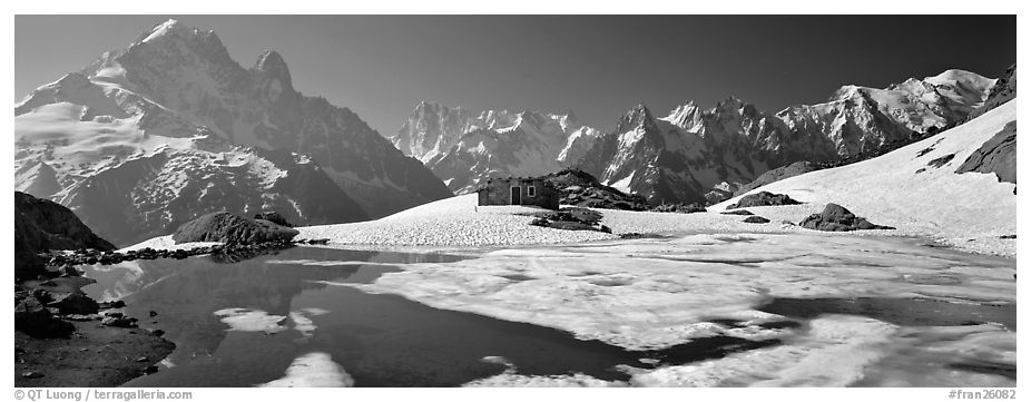 Panoramic black and white picture photo high mountain landscape with partly frozen lake and mont blanc range france
