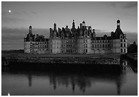 Chambord chateau at dusk with moonrise. Loire Valley, France (black and white)
