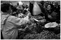 Shopping at the Fresh produce market, Saint Malo. Brittany, France (black and white)