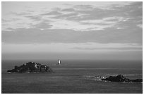 Islets and lighthouse on the coast. Brittany, France ( black and white)