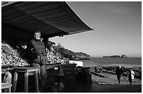 Oyster stand and vendor in Cancale. Cancale oysters are reknown in France. Brittany, France ( black and white)
