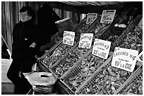 Stand with a variety of oysters in Cancale. Brittany, France (black and white)
