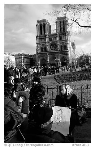 Sketch drawers in front of Notre Dame Cathedral. Paris, France (black and white)