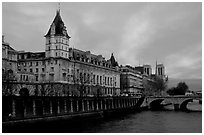 Conciergerie, Pont-au-change, and Ile de la Cite at sunset. Paris, France (black and white)