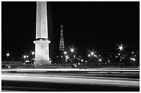 Car lights,  obelisk, and Eiffel Tower at night. Paris, France (black and white)