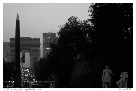 Obelisk of the Concorde and Arc de Triomphe at sunset. Paris, France (black and white)