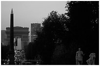 Obelisk of the Concorde and Arc de Triomphe at sunset. Paris, France ( black and white)
