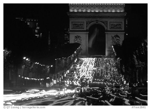 Arc de Triomphe and Champs Elysees at night with car light trails. Paris, France (black and white)