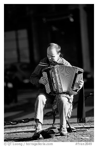 Accordeon player on the street. Paris, France (black and white)