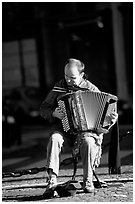 Accordeon player on the street. Paris, France ( black and white)