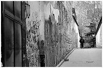 Boy in side alley with graffiti on walls. Paris, France (black and white)
