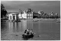 Rowers and Fontainebleau palace. France ( black and white)