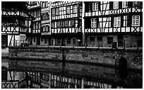 Half-timbered houses reflected in canal. Strasbourg, Alsace, France (black and white)