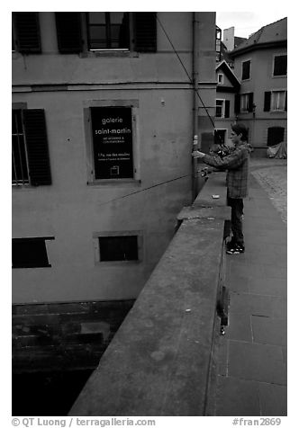Fishing in a canal. Strasbourg, Alsace, France (black and white)