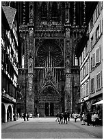 Facade of the Notre Dame cathedral seen from nearby street. Strasbourg, Alsace, France ( black and white)