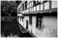 Half-timbered houses next to a canal. Strasbourg, Alsace, France ( black and white)