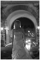Woman in bridal gown in front of the Louvre by night. Paris, France ( black and white)