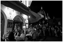 Outdoor restaurant at night on the Place du Tertre, Montmartre. Paris, France (black and white)