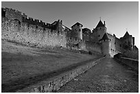 Path leading to old walled city. Carcassonne, France (black and white)