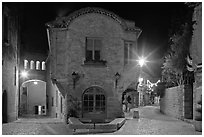 Stone buildings and streets at night. Carcassonne, France ( black and white)